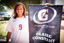 Claire Constant holding Gatorade Player of the Year banner.