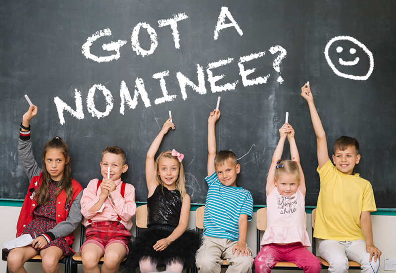 "children sitting in front of chalkboard with words ""got a nominee"""