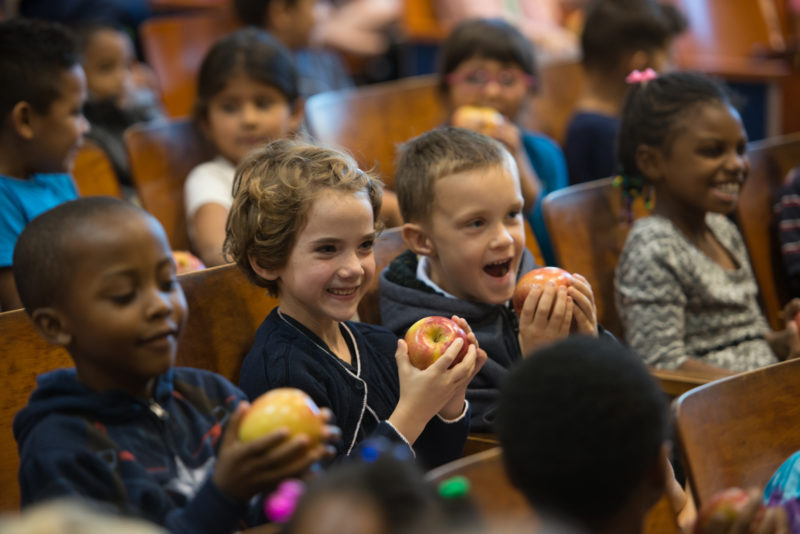 Charles Barrett students eating apples at an assembly for the Crunch Heard 'Round Virginia