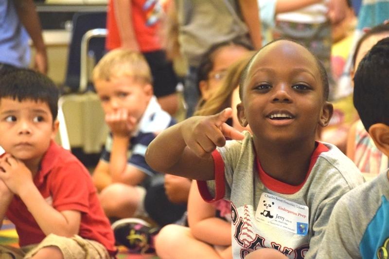 kindergarten student pointing