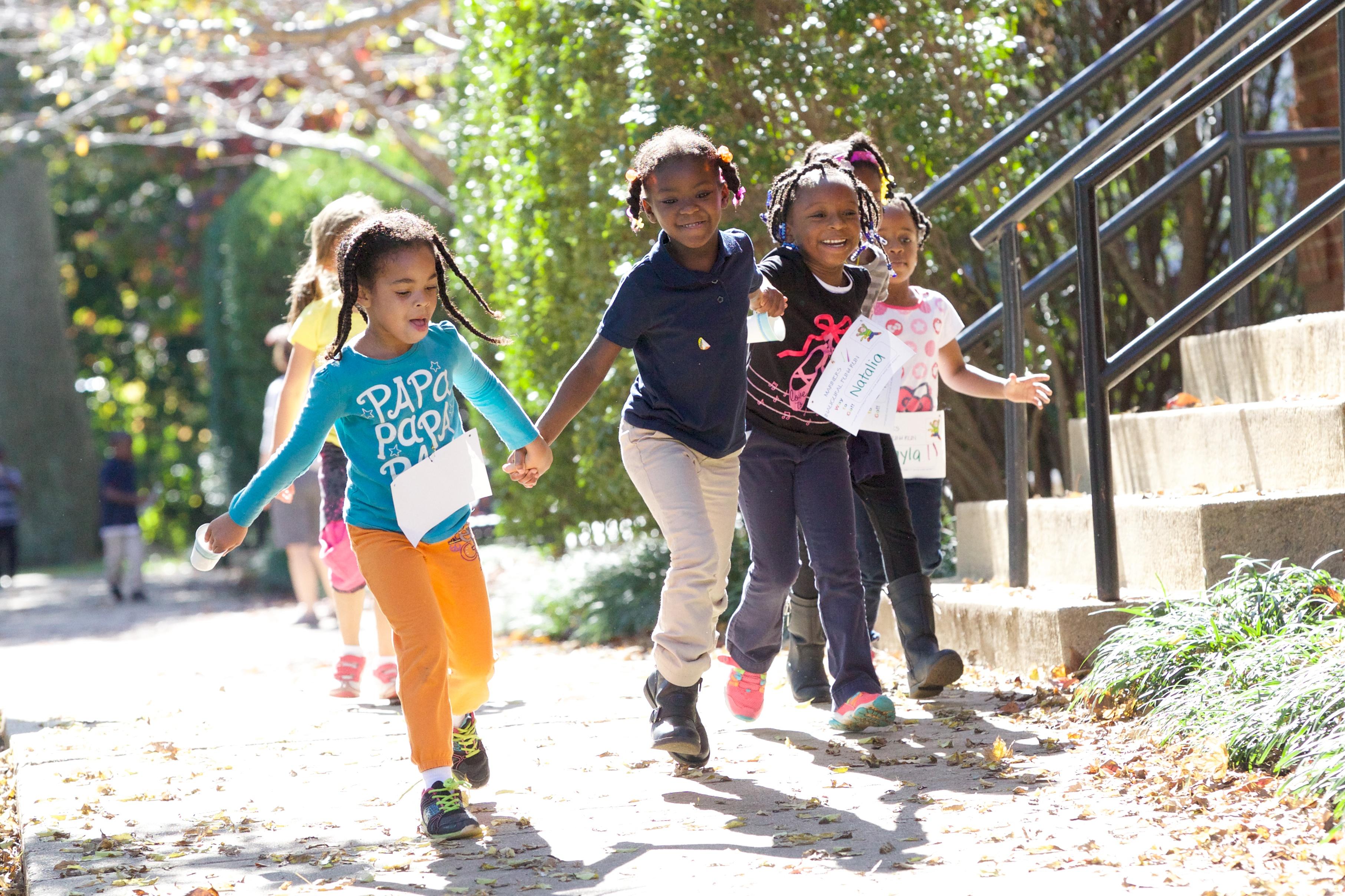 Kids skipping outside