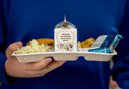 compostable lunch tray with carton of milk. joke on side of carton: why did chicken do jumping jacks?
