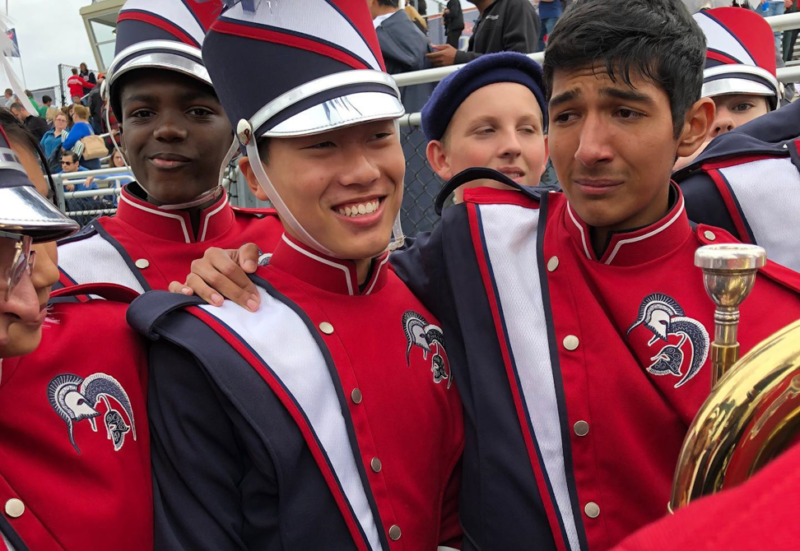 members of TC Williams react with tears and smiles to earning a SUPERIOR rating in the 2019 VBODA State Marching Assessment