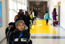 children walking through hallway at Patrick Henry