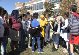 Jefferson-Houston School students in Halloween costumes outside sharing their thoughts on voting