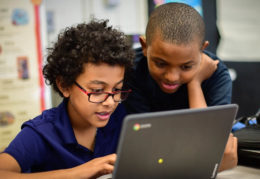two boys at a computer