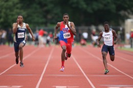 Noah Lyles racing against two other runners