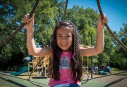 Closeup of female elementary student on playground