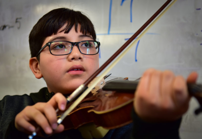 Fifth-grader Eddy Paz is a member of the Fiddle Factory ensemble