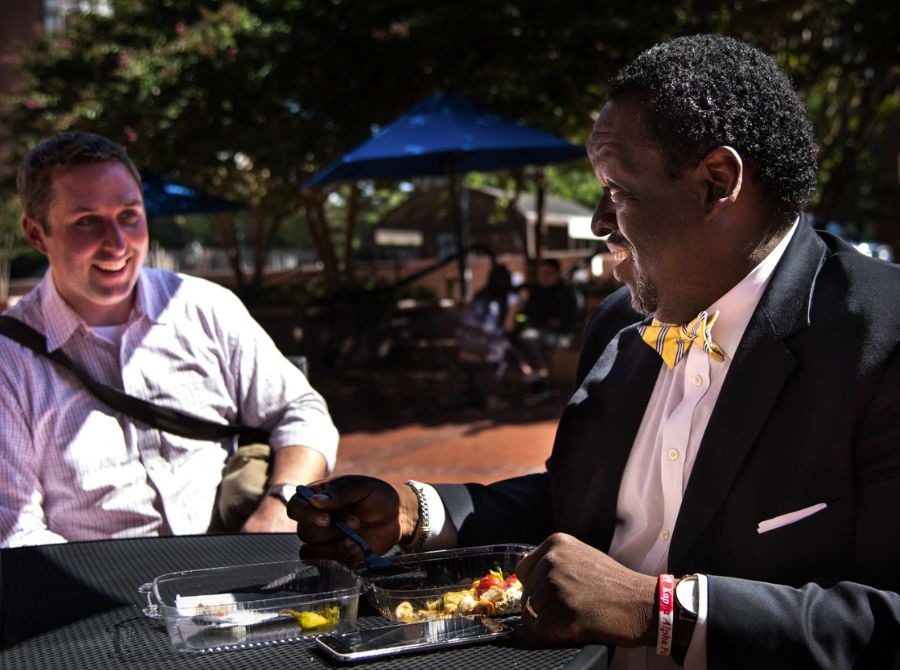Two male ACPS employees enjoying lunch outside