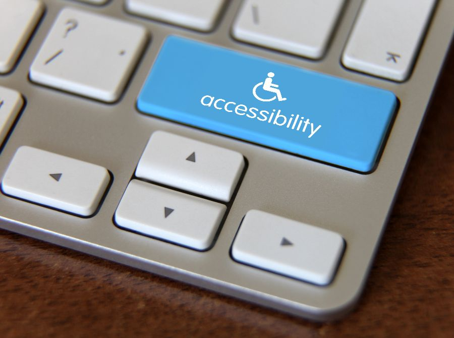 keyboard with blue button that says accessibility