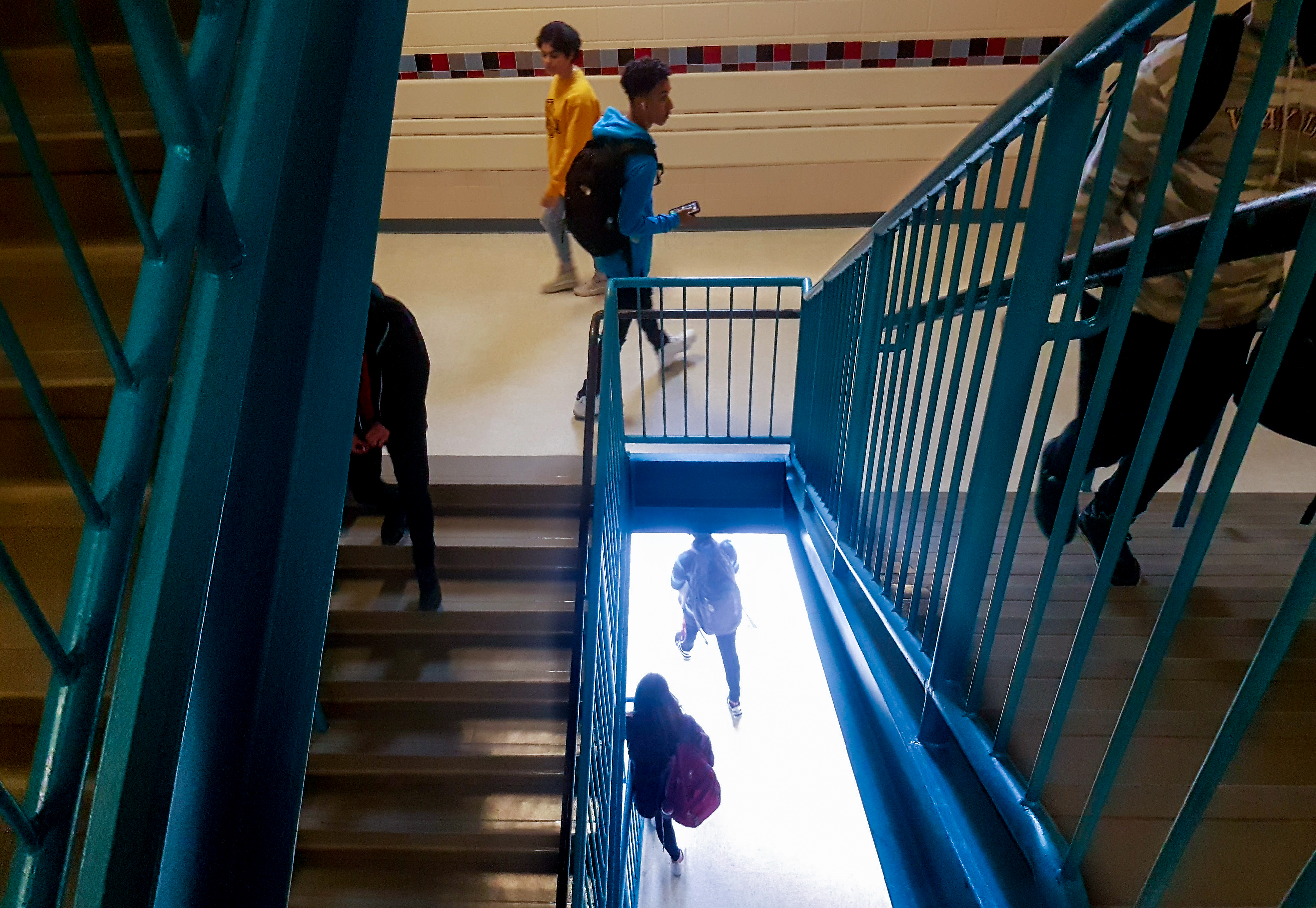 TC Williams stairwell with students