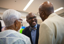 Dr Hutchings talks with guests at Ferdinand T. Day ribbon cutting