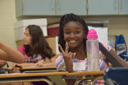 Francis C. Hammond student in classroom giving peace sign