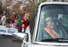 JROTC sitting in a classic car at the Scottish Walk Parade