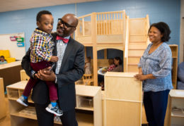 Dr. Hutchings holding pre-school student on day one