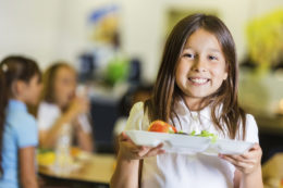 Female student holding lunch tray