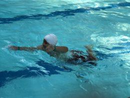 student learning swim skills