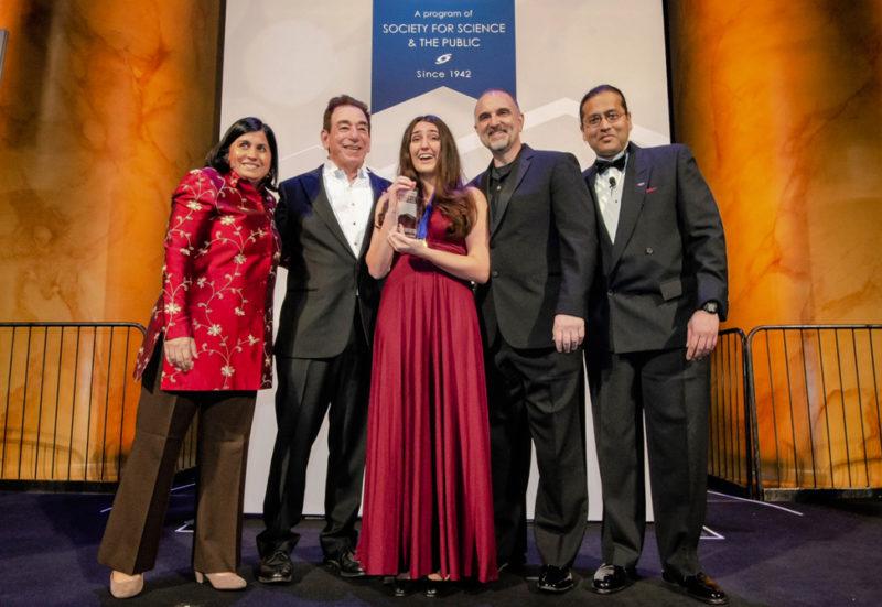Ana Humphrey accepts Regeneron award on stage