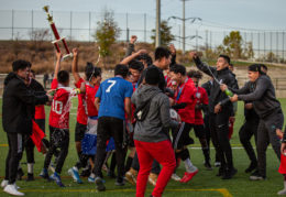 Athletico celebrates with their trophy after winning the league championship