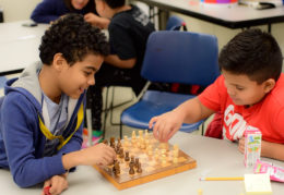 Students at Brent Place play a game of chess