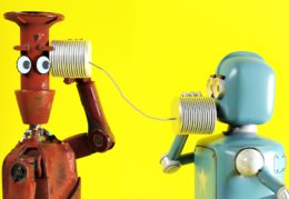 robots communicating with two tin cans and a string