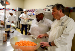 Chef in the TC kitchen with culinary students