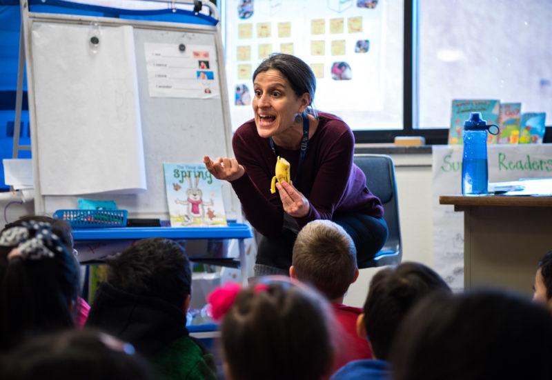 Deborah Haiman talks to her kindergarten class about the characteristics of a banana