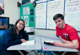Paula and Paul sitting at their desks in German class