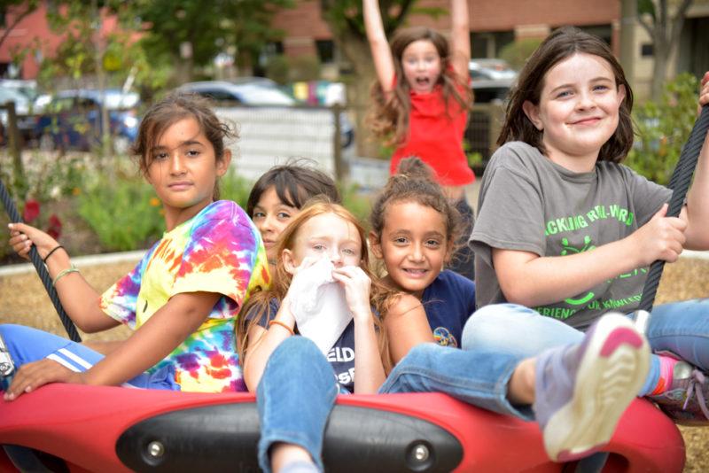 students on playground equipment