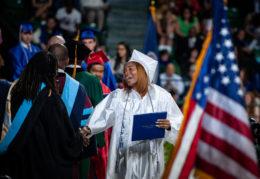 student receives diploma at graduation