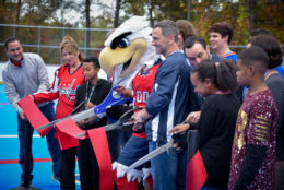 Slapshot and community cut the ribbon at hockey rink