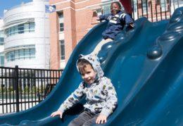 two boys on a slide at Jefferson-Houston playground