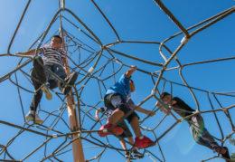 kids on spiderweb playground equipment