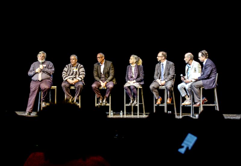 panelists answer questions at TC auditorium