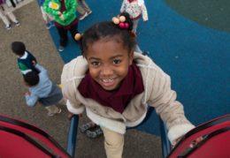 kindergartener on playground at Jefferson-Houston