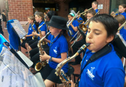 student musicians perform outside before school board meeting
