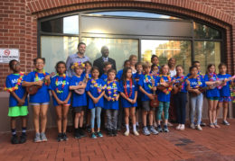 students with ukuleles before the