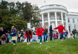 children roll Easter eggs on the White House lawn