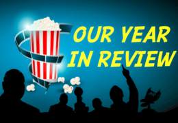 silhouettes against a movie screen that says Our Year in Review