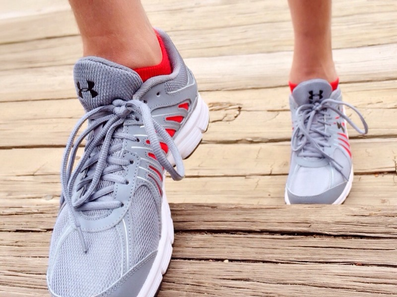 feet in sneakers running up stairs